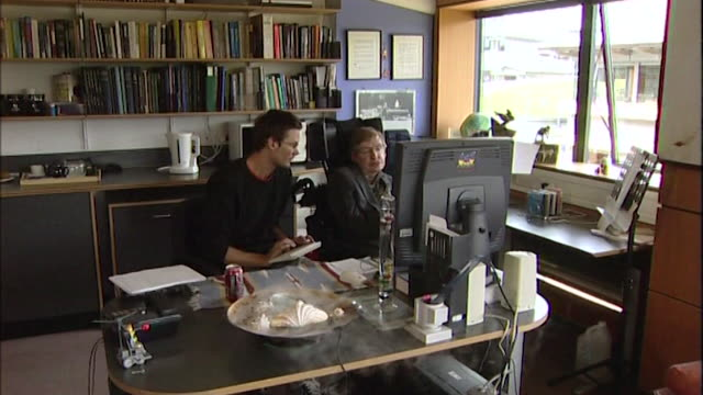sequence of shots showing stephen hawking in his room with a student at cambridge university cambridge - theology stock videos and b-roll footage