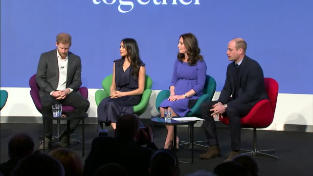vídeos de stock, filmes e b-roll de sequence of shots showing the duke and duchess of cambridge and prince harry and meghan markle taking to the stage at the royal foundation forum - realeza