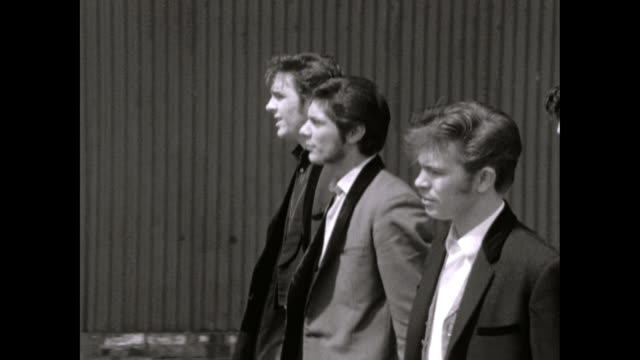ms sequence of teddy boy gangs walking on pavement - run down stock videos & royalty-free footage