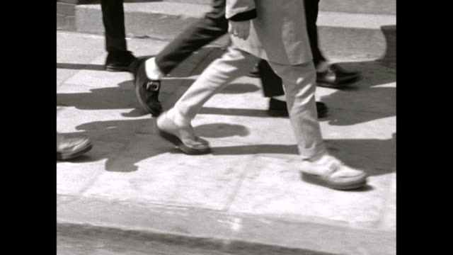 ms sequence of teddy boy's shoes walking on pavement - human leg stock videos & royalty-free footage