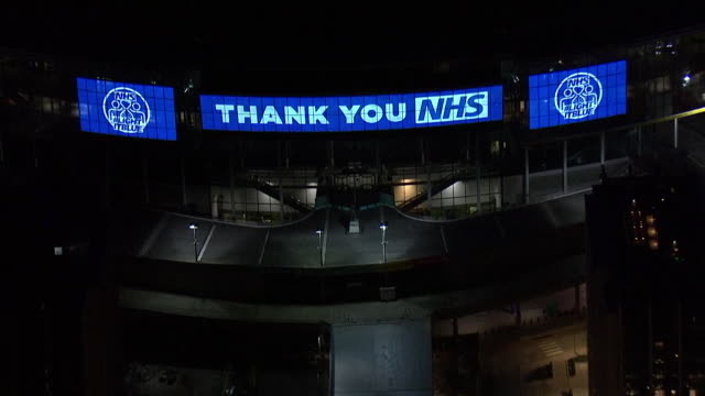 sequence of the clap for carers as the uk applaud the nhs for their work during the coronavirus crisis as london landmarks are lit up blue including... - nhs stock-videos und b-roll-filmmaterial
