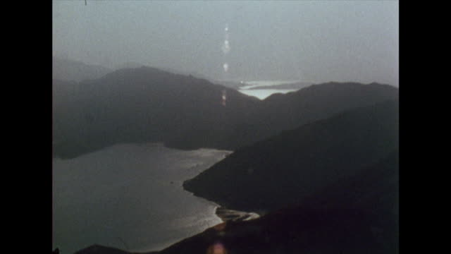 sequence of the landscape surrounding hong kong; 1972 - hill stock videos & royalty-free footage