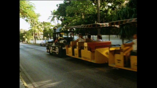 sequence of tourists in key west in florida, 1991 - trolley bus stock videos & royalty-free footage