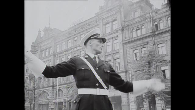 sequence of trams and a policeman directing traffic in helsinki during the 1952 summer olympic games - summer olympic games stock videos and b-roll footage