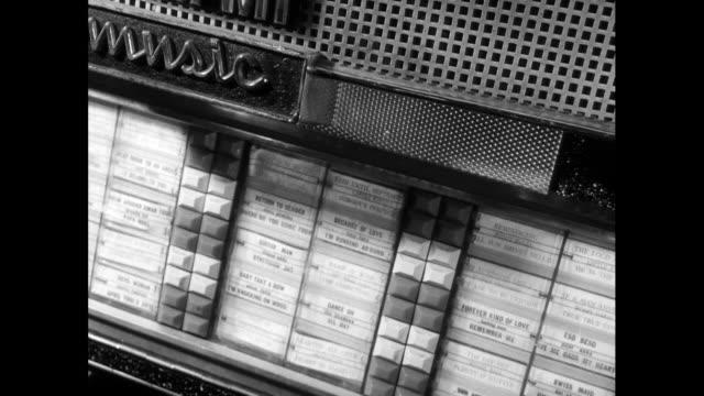 sequence of various b&w jukebox shots; 1963 - jukebox stock videos & royalty-free footage