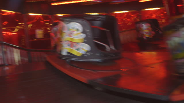 sequence of views of empty waltzer cars twirling around a retro waltzer fairground ride, uk. - fairground stock videos and b-roll footage