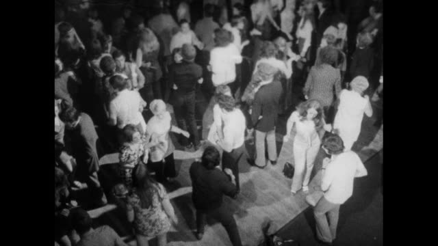 sequence of young adults dancing in a nightclub; 1971 - waist stock videos & royalty-free footage