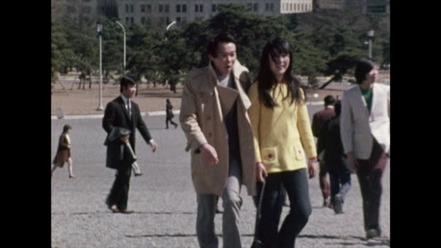 sequence of young adults in tokyo city; 1972 - showa period stock videos & royalty-free footage