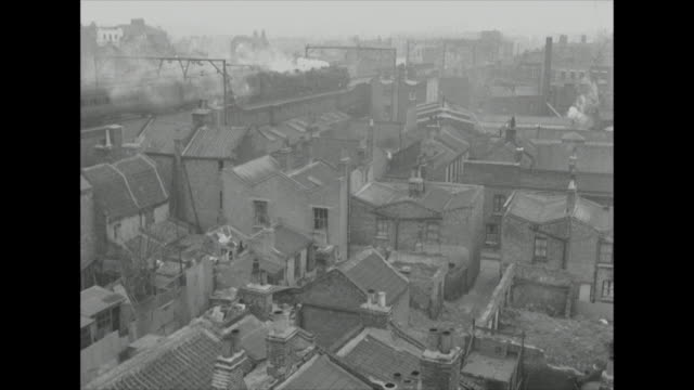 sequence over the rooftops of tenement buildings in the wapping area of london. - slum stock videos & royalty-free footage