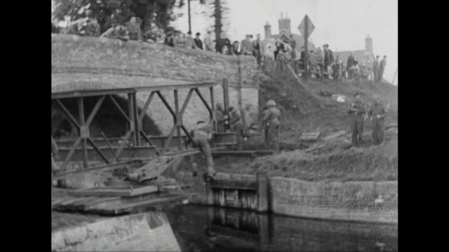 sequence showing a bailey bridge being built during a military exercise in wiltshire - historical reenactment stock videos and b-roll footage