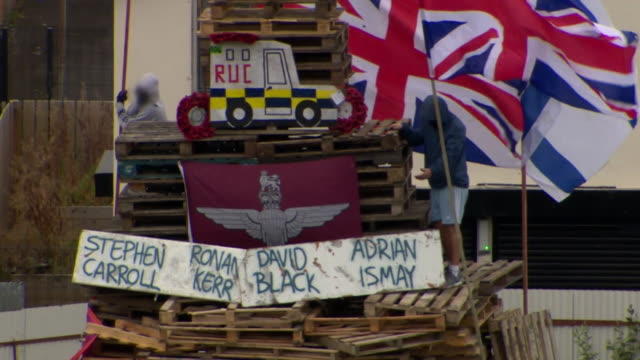 sequence showing a bonfire with the names of murdered police officers in derry northern ireland - northern ireland stock videos & royalty-free footage