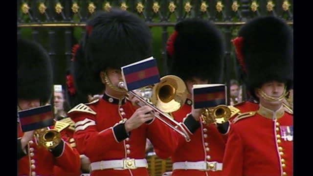 sequence showing a break with tradition, when the queen's guard played the us national anthem during the changing of the guard at buckingham palace... - real people stock videos & royalty-free footage