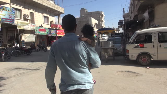 sequence showing a british jihadist shopping with his child in idlib, syria - war and conflict stock videos & royalty-free footage
