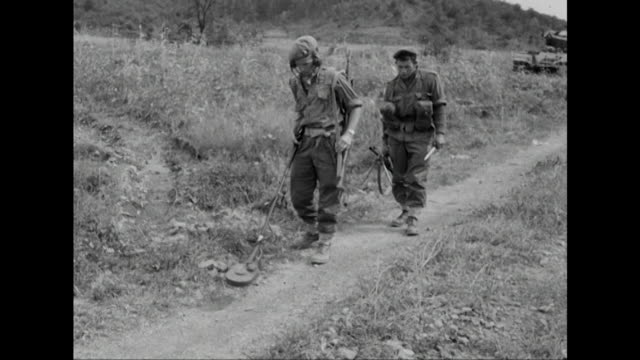 sequence showing a british mine detector team at work in south korea - minesweeping stock videos & royalty-free footage