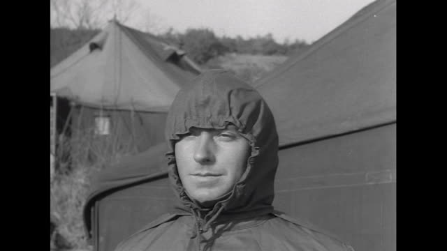 Sequence showing a British soldier trying on new winter clothing and equipment during a deployment in Korea