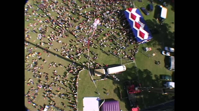 sequence showing a bungee jump taking place at pride at preston park in brighton in the year 2000, including a man looking upwards anxiously as... - construction machinery stock videos & royalty-free footage