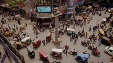sequence showing a busy bike and rickshaw traffic in varanasi, uttar pradesh, india. - india stock videos & royalty-free footage