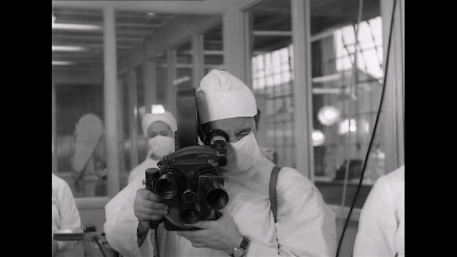 sequence showing a cameraman filming people at work in a new pharmaceutical laboratory - laboratory equipment stock videos & royalty-free footage