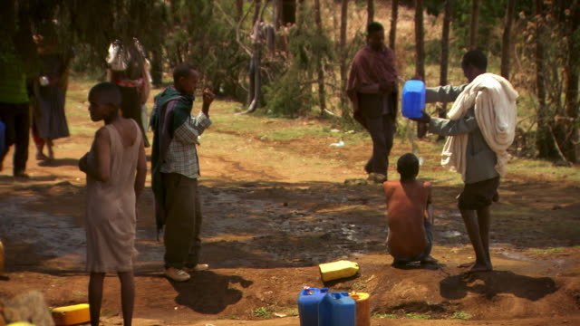 sequence showing a christian man being washed with the holy water of the blue nile at gish abay.  - holy water stock videos & royalty-free footage