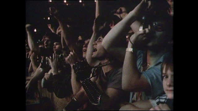 sequence showing a crowd of people cheering and enjoying a kiss rock concert in new orleans, usa; 1983. - gulf coast states stock videos & royalty-free footage