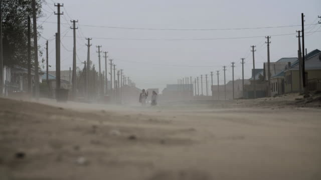 sequence showing a dust storm in a town affected by the loss of the aral sea, kazakhstan. - dust storm stock videos & royalty-free footage