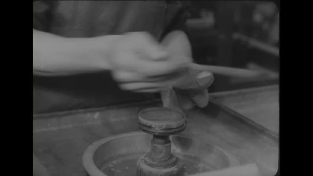 sequence showing a factory worker polishing a small reflector mirror. - reflector stock videos & royalty-free footage