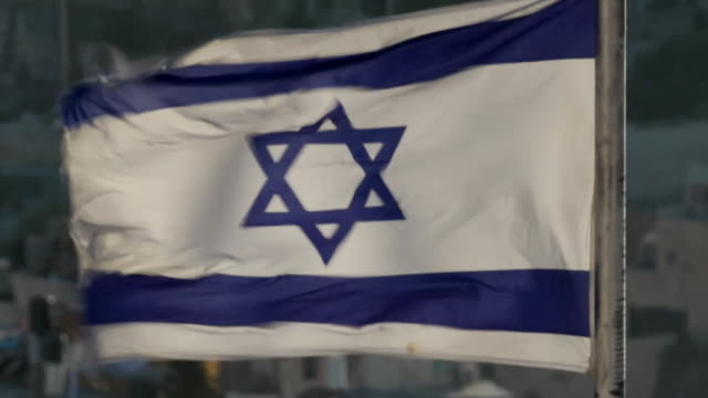 sequence showing a flag with the star of david and a wide view of the city of jerusalem - star of david stock videos and b-roll footage
