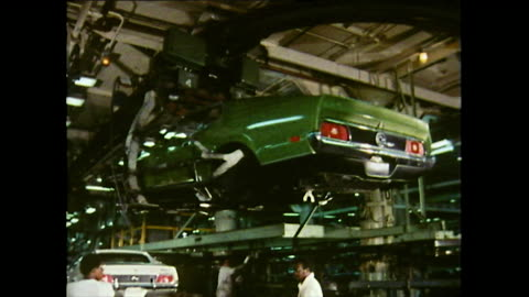 sequence showing a green ford mustang is carried by a mechanical hoist and lowered onto the production line by male workers at the ford river rouge... - 1972 stock videos & royalty-free footage