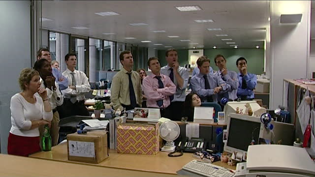 sequence showing a group of city workers in an office and watching the 9/11 terror attacks unfold on the news; september 11th 2001. - group of people stock videos & royalty-free footage