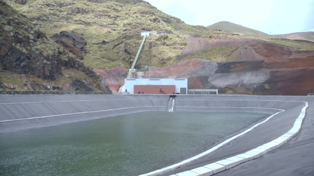 sequence showing a half full reservoir on the island of el hierro. - reservoir stock videos and b-roll footage