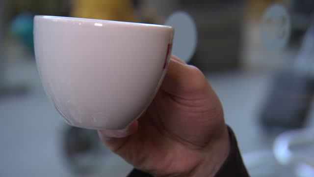 sequence showing a hand using a tea set in a train station cafe, uk. - station stock-videos und b-roll-filmmaterial