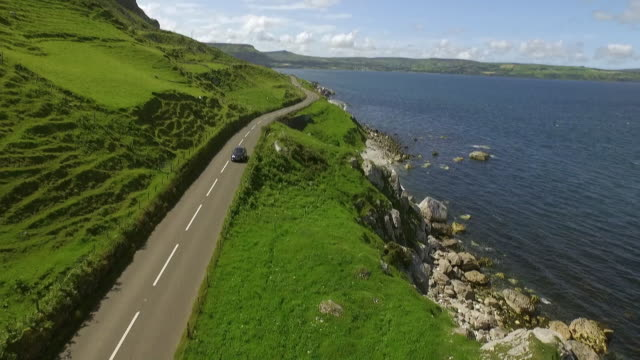 sequence showing a journey along the causeway coastal route on the east coast of northern ireland. - northern ireland stock videos & royalty-free footage
