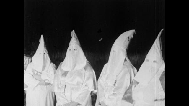 sequence showing a klu klux klan meeting at night in the usa; 1965. sign advertising meeting / hooded klansmen directs cars into car park / klansmen... - ku klux klan stock videos & royalty-free footage