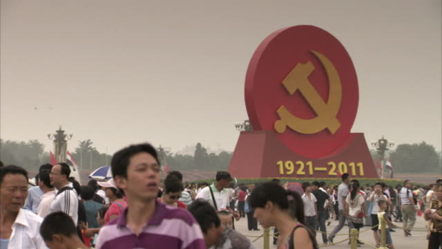 Sequence showing a large commemorative hammer and sickle in Tiananmen Square in Beijing, China.
