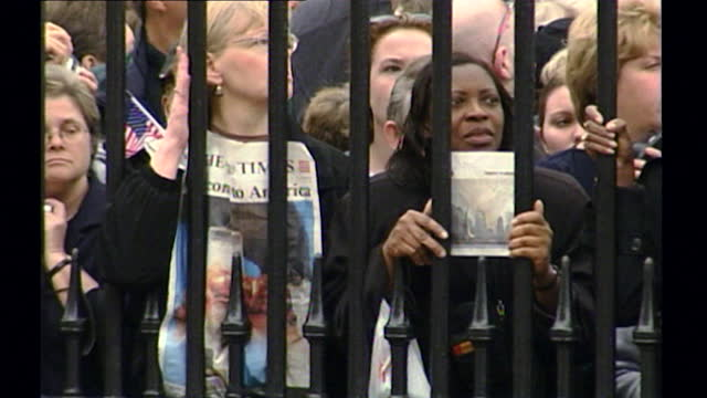 sequence showing a large crowd of people standing at the gates of buckingham palace, holding a minute's silence to remember the victims of the 9/11... - real people stock videos & royalty-free footage