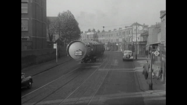 Sequence showing a large distillation column being transported through the streets of London