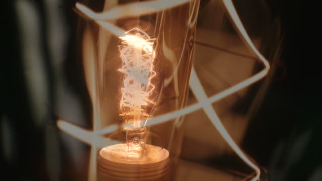 sequence showing a light bulb being switched on - filament stock videos & royalty-free footage