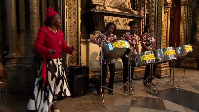 Sequence showing a man dancing to steel drums at the Windrush commemoration in Westminster Abbey