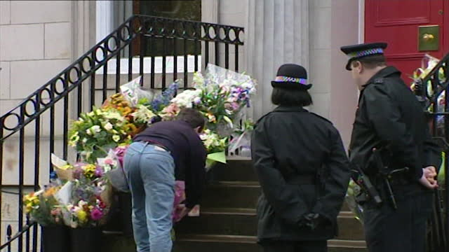 sequence showing a man laying flowers on the steps of the us consulate in edinburgh in honour of the victims of 9/11; september 13th, 2001. man... - real people stock videos & royalty-free footage