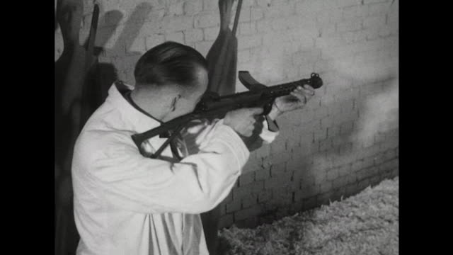 sequence showing a man test firing a new sterling submachine gun at a firing range. - submachine gun stock videos & royalty-free footage
