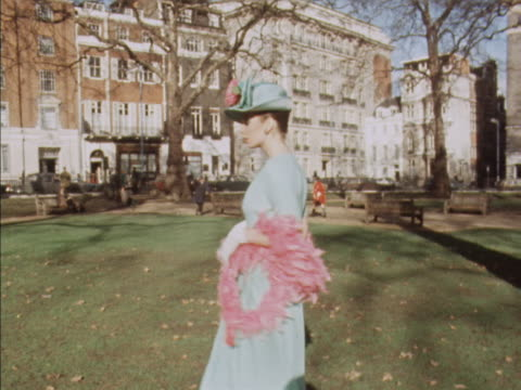 Sequence showing a model wearing a blue dress and feather boa designed by Lachasse