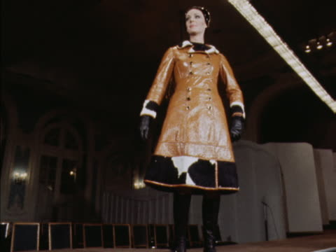 stockvideo's en b-roll-footage met sequence showing a model wearing a leather and cow hide coat designed by veneziani - designerkleding