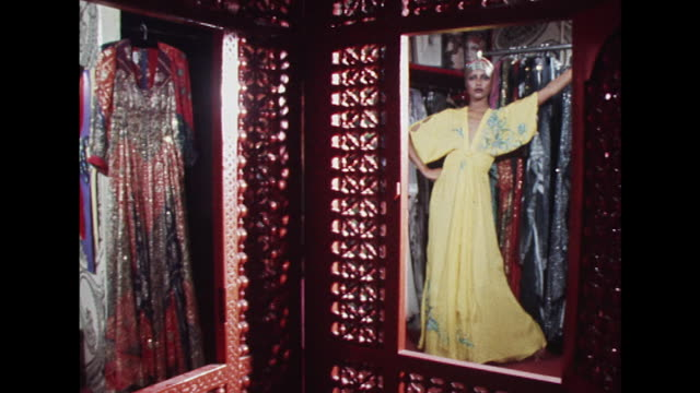 Sequence showing a model wearing a yellow Thea Porter evening gown