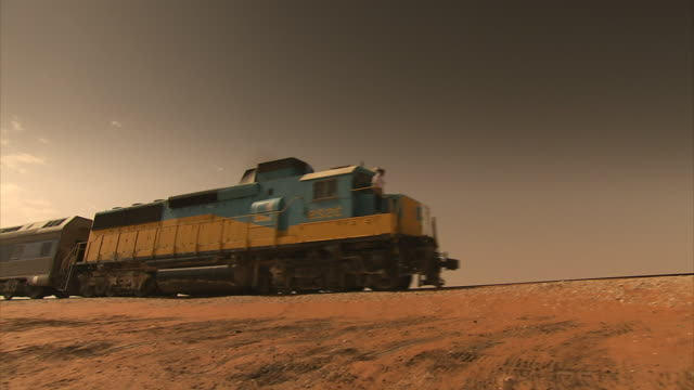 sequence showing a passenger train travelling across the saudi arabian desert. - train vehicle stock videos & royalty-free footage