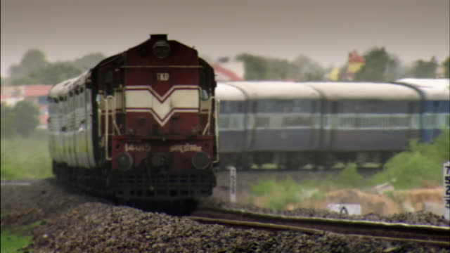 Sequence showing a passenger train travelling across the Western State of Gujarat, India.