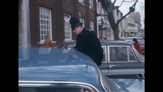 Sequence showing a policeman patrolling a high street