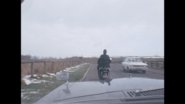 Sequence showing a policeman pulling over a driver as they travel along a road