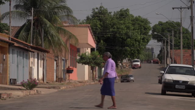 sequence showing a road in a brazilian town or village - überqueren stock-videos und b-roll-filmmaterial