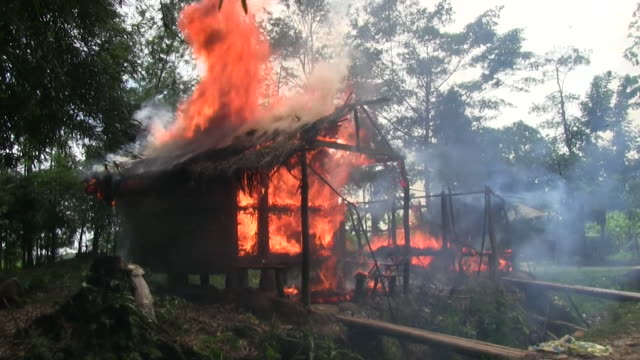 Sequence showing a Rohingya village being burnt to the ground by Rakhine Buddhists in the presence of the police Burma early September 2017 NNBZ122H...