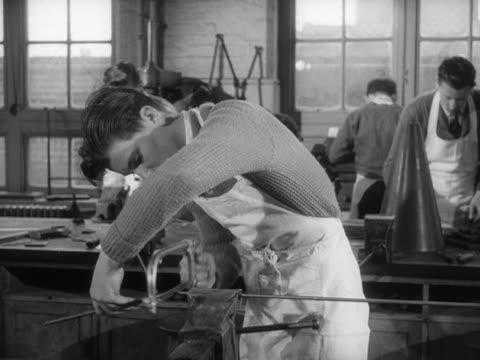 sequence showing a school boy bending a piece of metal in a vice during a metalwork lesson - metalwork stock videos and b-roll footage